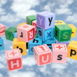 Assorted play blocks on clouds — Stock Photo