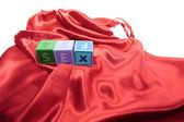 Sex on letter cubes on silk nightie — Stock Photo