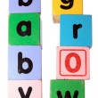 Baby grow in toy play block letters with clipping path — Stock Photo