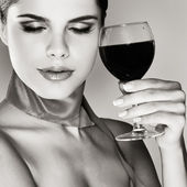 Beautiful young girl with glass of wine — Stock Photo