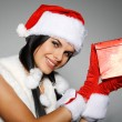 Beautiful and sexy woman wearing santa clause costume — Stock Photo #6770001