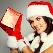 Beautiful and sexy woman wearing santa clause costume — Stock Photo #6770003