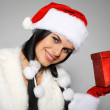 Beautiful and sexy woman wearing santa clause costume — Stock Photo #6770004
