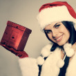 Beautiful and sexy woman wearing santa clause costume — Stock Photo #6770006