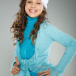 A little beautiful girl is in autumn clothes — Stock Photo #6885108