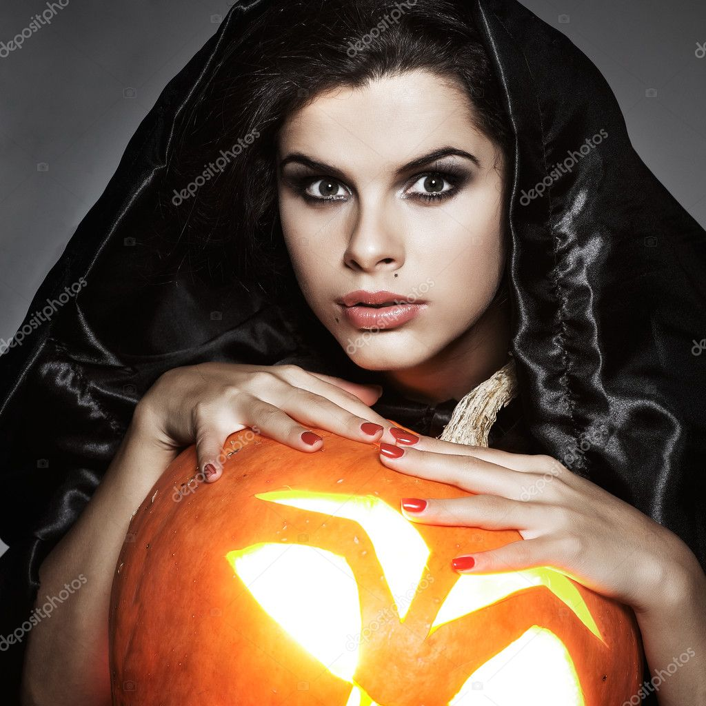 Sexual brunette in the suit of witch in night of Halloween  Stock Photo #6947177