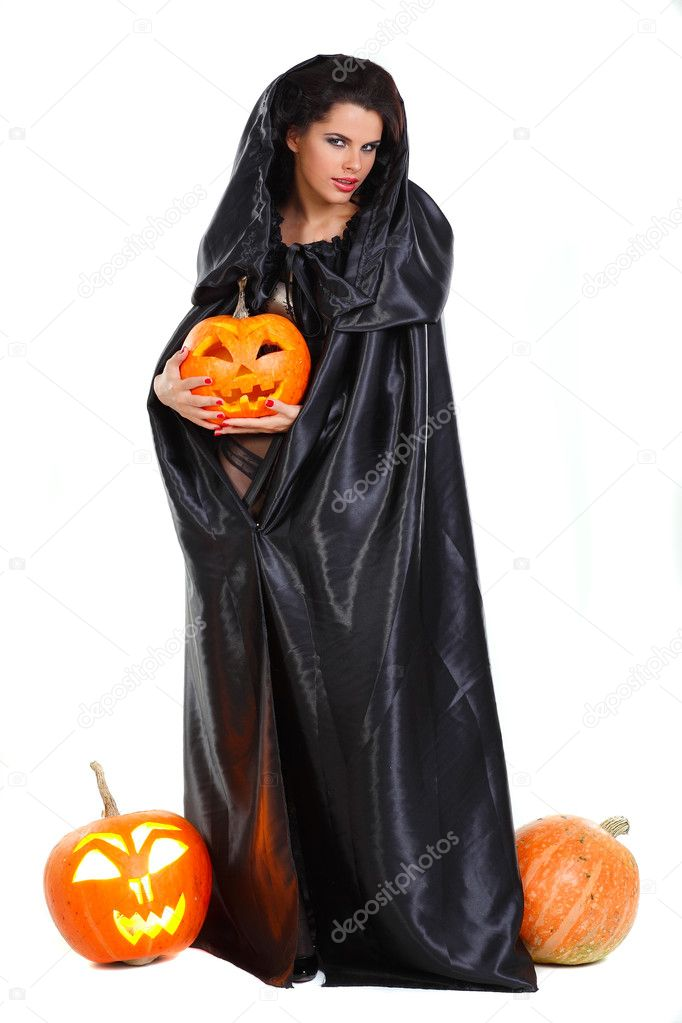Sexual brunette in the suit of witch in night of Halloween — Stock Photo #6947198