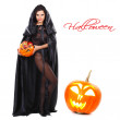 Sexual brunette in the suit of witch in night of Halloween — Stock Photo #7116723
