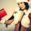 Stock Photo: Beautiful and sexy woman wearing santa clause costume