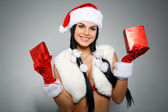 Beautiful and sexy woman wearing santa clause costume — Stock Photo