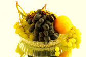 Grapes and a lemon in the glass vase — Stock Photo