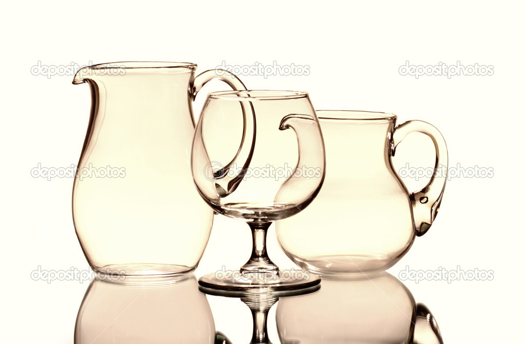 One wineglass and two empty jugs on the mirror — Stock Photo #6856631