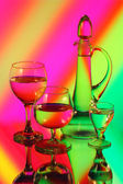 A glass jug and three wineglasses — Stock Photo