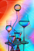 Four wineglasses, a vase and a glass ball — Stock Photo