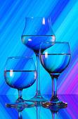 Three wineglasses on the mirror — Stock Photo