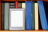 Ebook and old books on bookshelf — Stock Photo