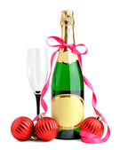 Bottle of champagne, wineglass and Christmas balls isolated on white backgr — Stock Photo