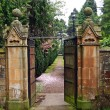 Old, beautiful gate leading to the garden — Stock Photo