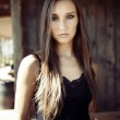 Sexy fashion young girl in black clothes — Stock Photo