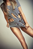 Sexy glamour young girl body in ripped shirt — Stok fotoğraf