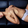 Sexy glamour young girl on sofa — Stock Photo