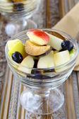 Glass bowl of fresh sweet fruit salad — Stock Photo