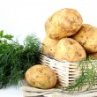 Basket of fresh organic potatoes — Stock Photo