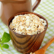 Oat flakes and milk - concept of a healthy breakfast - Stock Photo