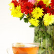 Still life with flowers and cup tea — Stock Photo #7227153