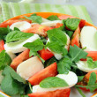 Traditional Italian Caprese Salad mozzarella with tomatoes and basil — Stock Photo