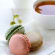 Royalty-Free Stock Photo: Traditional french macarons with tea set on the background