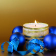 Christmas composition with candle and decorations — Stock Photo