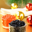 Red and black caviar in glass jars — Stock Photo