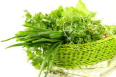 Fresh green grass parsley dill onion herbs mix in a wicker basket — Stock Photo