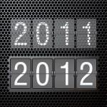 2012 new year on mechanical scoreboard — Stock Vector #7504914