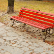 Red bench in park — Stock Photo