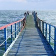 Old wooden sea pier - Stock Photo