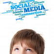 Young head looking at social type of icons and signs — Stock Photo #6852776