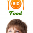 Young head looking at healthy food sign — Stock Photo