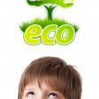 Young head looking at green eco sign — Stock Photo #6852827