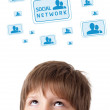 Young head looking at social type of icons and signs — Stock Photo #6852841
