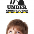 Young head looking at contruction icons — Stock Photo #6852876