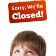 Young persons head looking at closed and open signs — Stock Photo #6852894