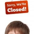Royalty-Free Stock Photo: Young persons head looking at closed and open signs