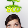 Young girl looking at green eco sign - Stock Photo