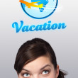 Foto Stock: Young girl looking at vacation type of sign
