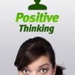 Young girl looking at positive negative signs - Stock Photo