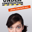 Young girl looking at contruction icons — Stock Photo #6853859