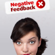 Young girl looking at positive negative signs — Stock Photo