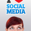 Young girl looking at social type of icons and signs — Stock Photo #6854083